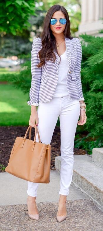 Model sports an all white ensemble with a fitted striped blazer, nude heels and a tan handbag, reflective glasses add to the modern feel