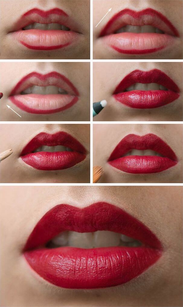 Lips outlined with thick lip liner and filled with red lipstick, concealer to line outer lips
