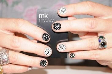 Alternating black and white bases with alternate polka dots on every nail