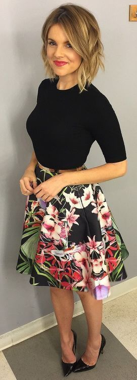 Model is wearing a basic black tee and pointy stilettos with the floral skirt to keep the formal and smart look