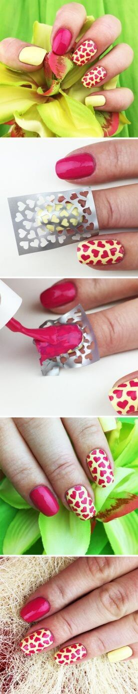 Nails are painted with red hearts using a stencil over a yellow base