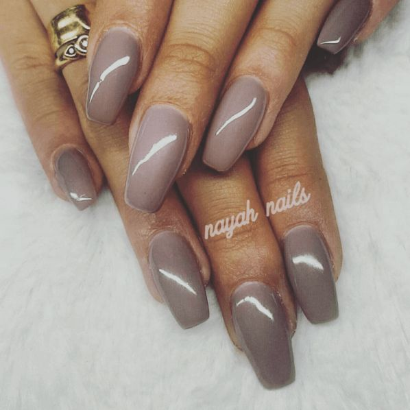 Long taupe nails with warm undertones