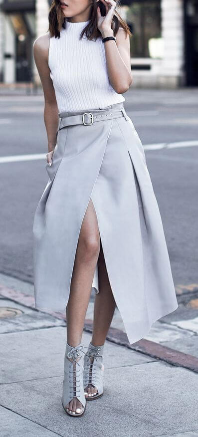 Woman in beige grey skirt and white top