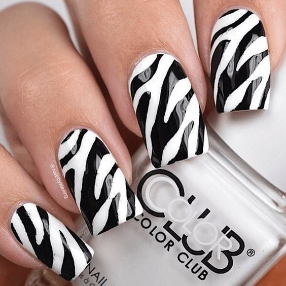 Best paired with your black nail polish is the animal print design.