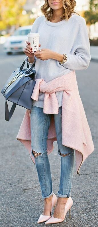Woman in blue jeans and soft pink sweater