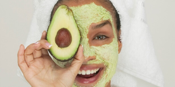 Woman smiling with avocado face mask