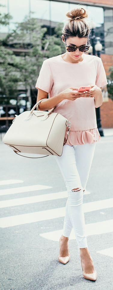 Woman in pink and subtle nude shades outfit on the street