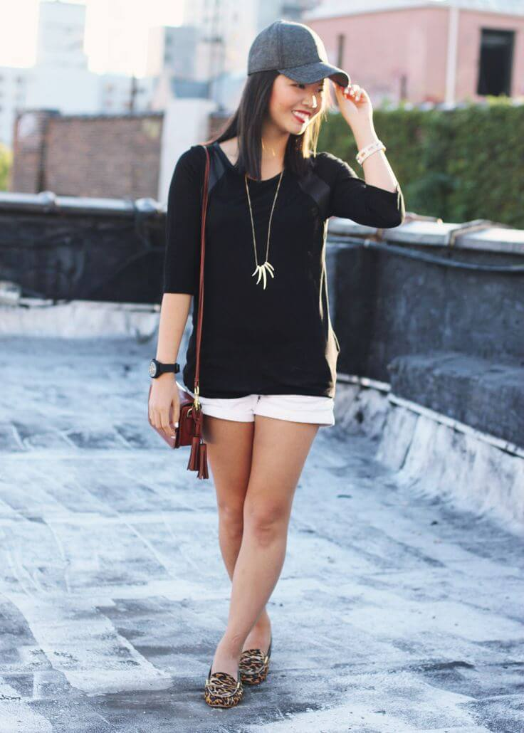 Young woman on the sidewalk looking sporty and stylish