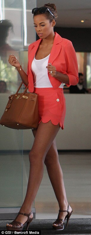 Just Peachy: The warmth created by this coral shorts suit perfectly plays up the golden tones in Rochelle Humes' skin.