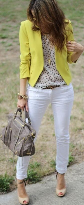 Woman in a bright outfit including white jeans