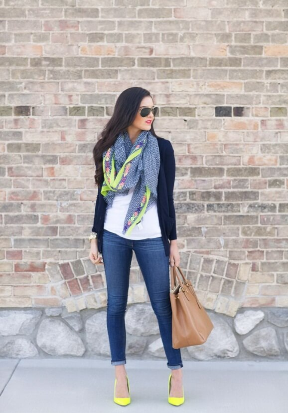 Elegant and feminine woman wearing skinnies and a navy knit cardigan