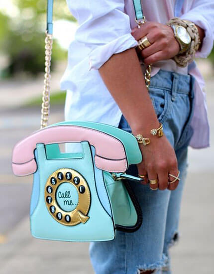 Woman having a statement bag (a colorful phone)