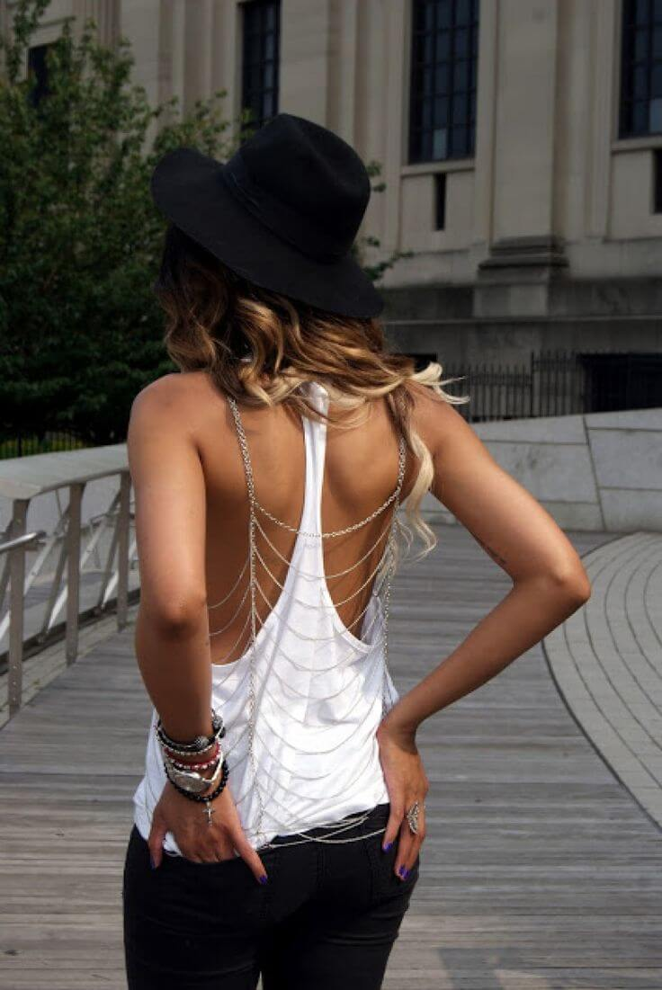 A girl wearing white tee and a body chain