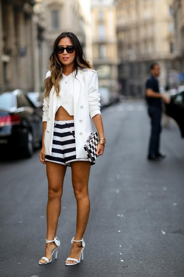 woman in a nice outfit containing striped shorts