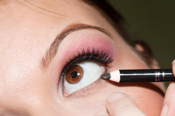 An eye with an eyeliner being applied