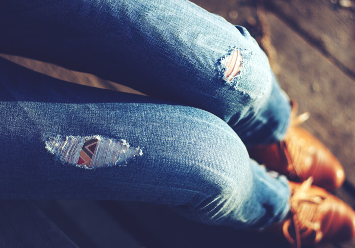 Picture of legs with torn vintage jeans