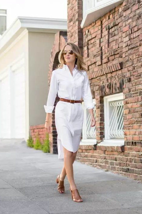 Woman in a shirtdress with brown belt
