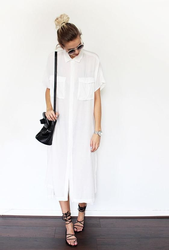 Woman in a white maxi shirtdress