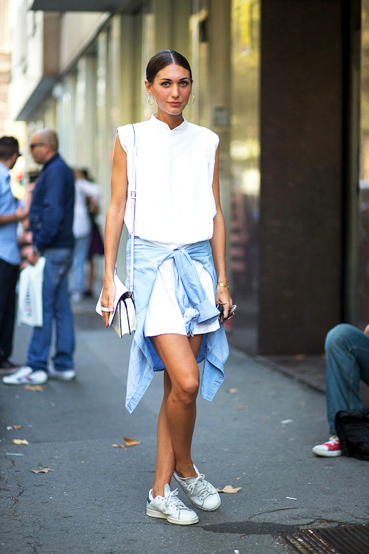 Woman in a white shirtdress with sneakers