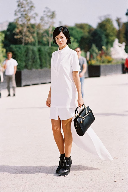 Woman in black boots and white shirtdress