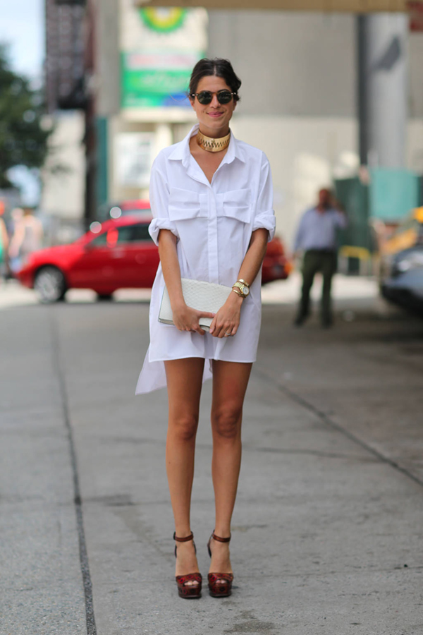 Woman in high-low white shirtdress on the street