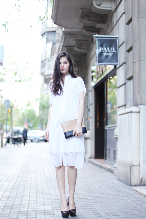 Woman in white flowy oversized shirtdress