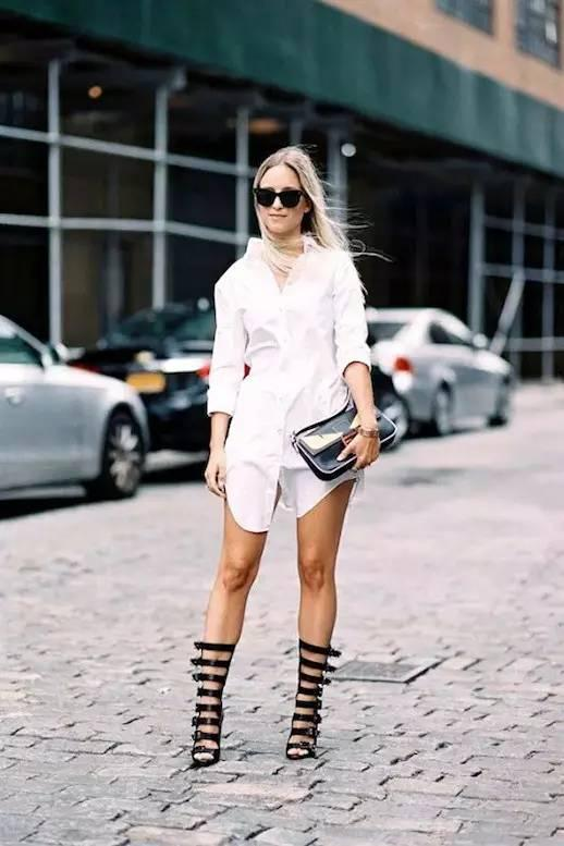 Woman in white shirtdress with black gladiator shoes