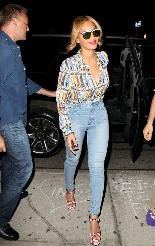 Tucked-in and Trim: Beyonce tucks a button-down shirt into a pair of high-waisted skinny jeans for a sleek effect.