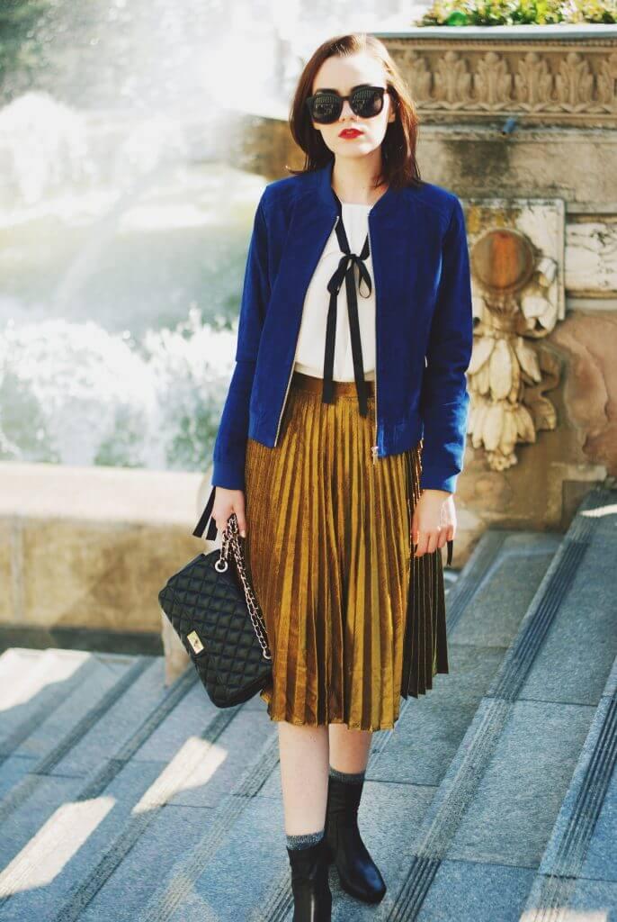 Woman wearing gold blue jacket