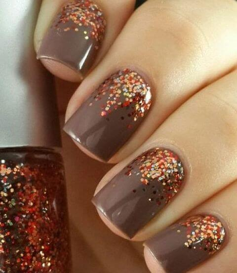 14 trendy nail designs this fall to make you stand out belletag grey brown nails with copper glitter concentrated near the cuticle prinsesfo Image collections