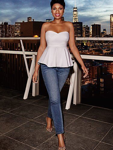 Jennifer Hudson wearing white top and blue jeans