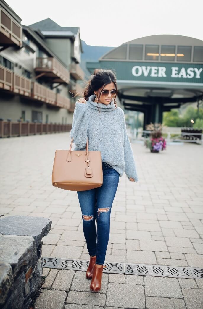 Lady wearing gray turtleneck sweater