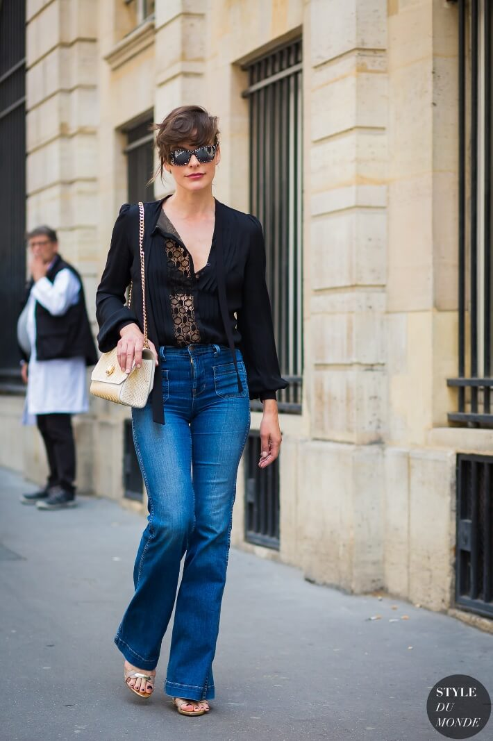 Actress Milla Jovovich walks the streets of Paris in high-waisted glamour.