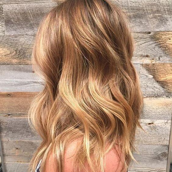 Profile of a woman with golden blonde wavy hair
