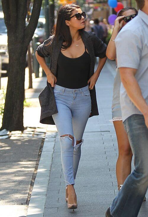 Distressed and Skinny: Selena Gomez's hourglass shape is perfect for slightly high-waisted jeans with ripped detailing.