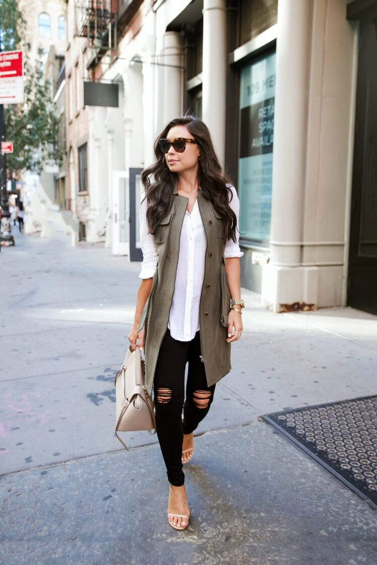 A khaki green long vest ups the street cred of this feminine look.