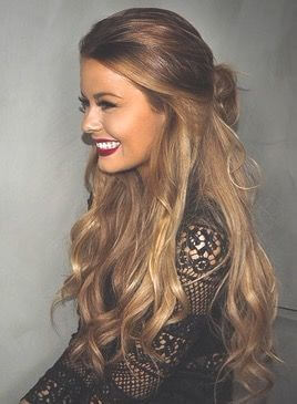 wavy, golden blonde hair tied in a half-up-half-down style