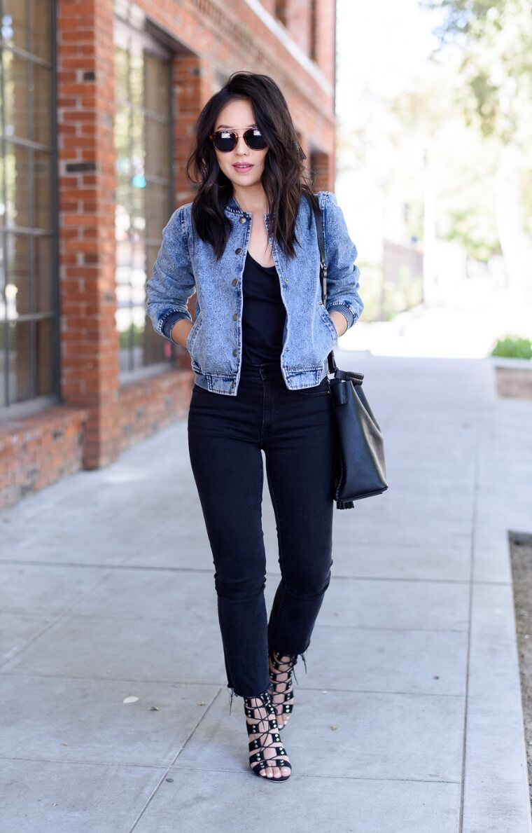 A backdrop palette of dark blue denim beautifully shows off a bomber jacket in a lighter wash.
