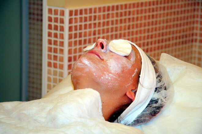 Woman lying down with a face mask