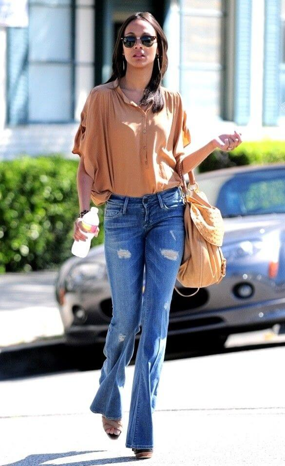 Soft, Flowing Sleeves: Big, billowing sleeves give Zoe Saldana's slim frame a rounder, more curvaceous shape.