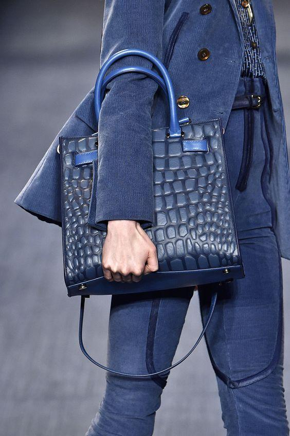Trussardi elegant look in total 'Riverside' color, with denim jeans and leather bag.