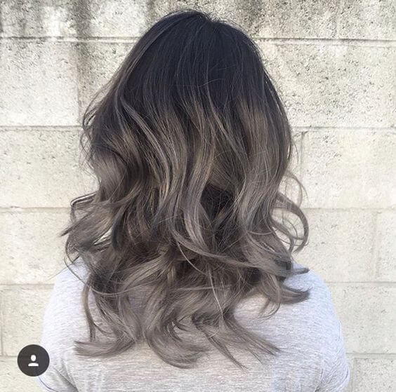 black, medium length wavy hair with silver ombre gradient