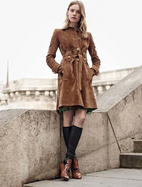 Blonde in suede trench coat