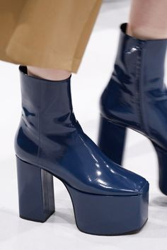 Definitely a more wearable option! Ankle length boots from Balenciaga, in deep blue vinyl, with high platforms and squared toes.