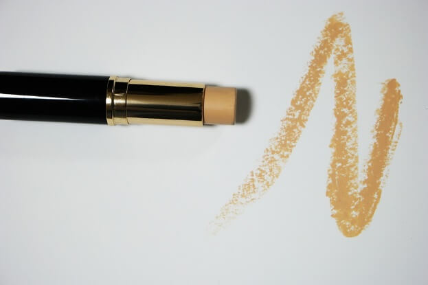 A creamy stick concealer in golden beige
