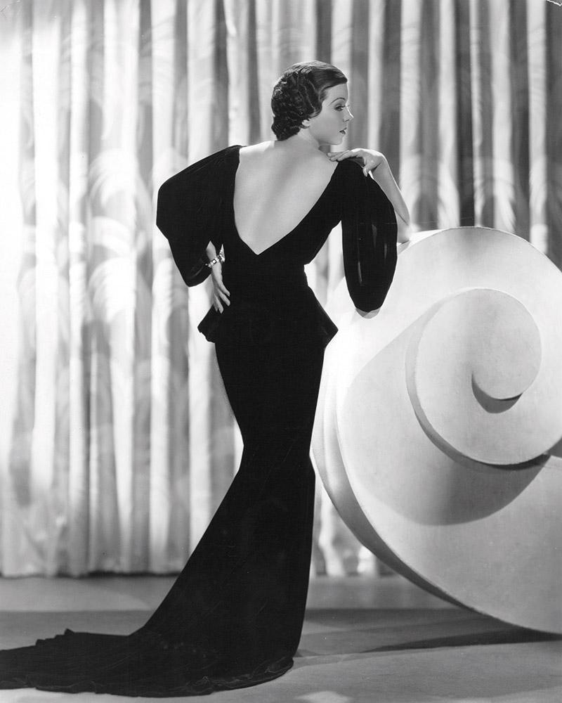 Frances Langford, Hollywood actress, is wearing a long backless gown