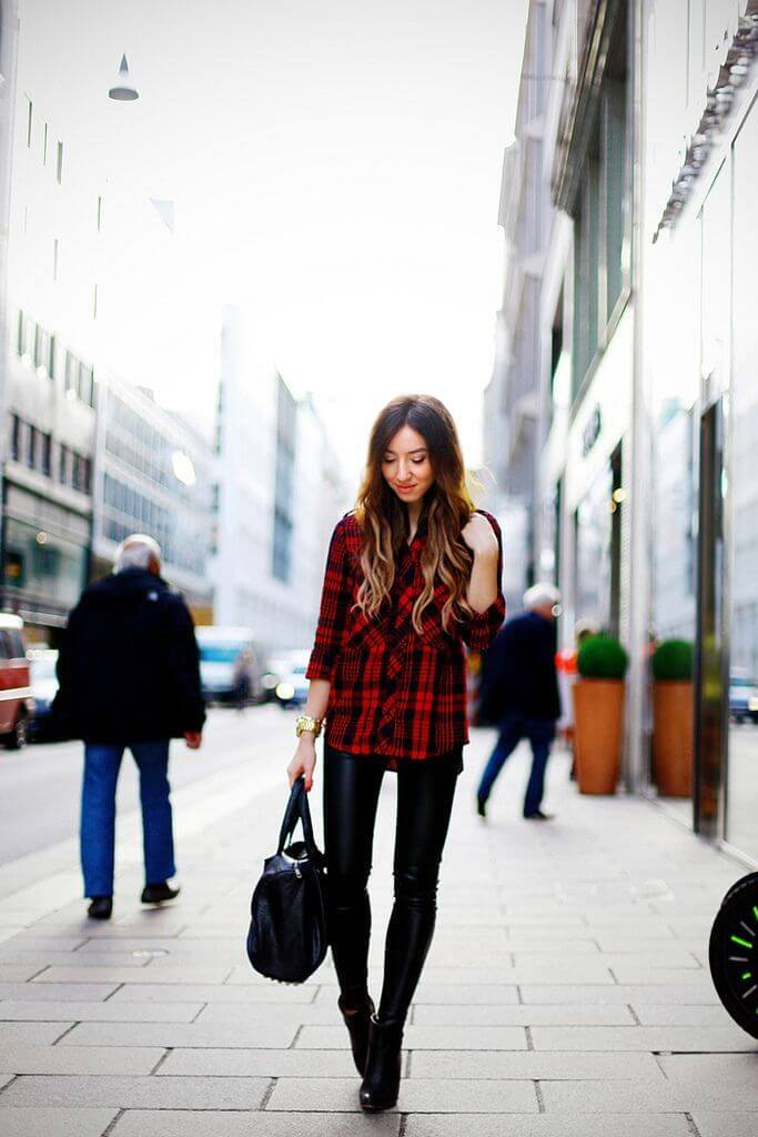 Urban look: plaid flannel shirt worn with leather trousers.