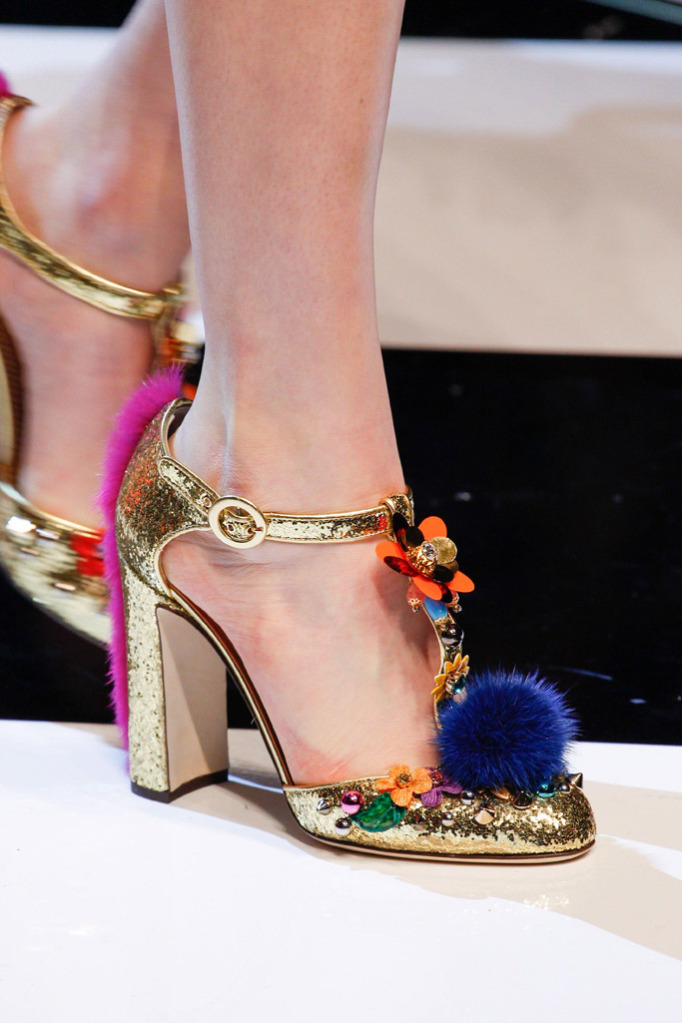 Gold metallic shoes with colorful details and furry pon pon