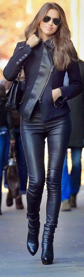Irina Shayk in black leather pants, black leather boots and black jacket with zip detailing