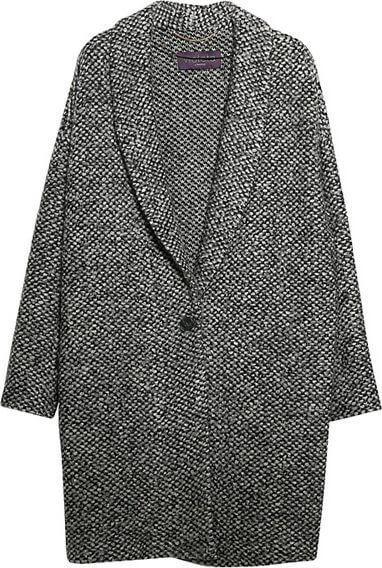 Knitted cocoon coat with a single central button.